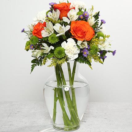 Orange Roses In Glass Vase: Daisies