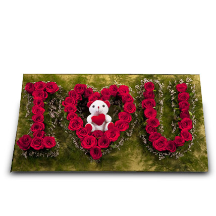 Cute Portrayal of Love: Anniversary Flowers and Teddy Bears