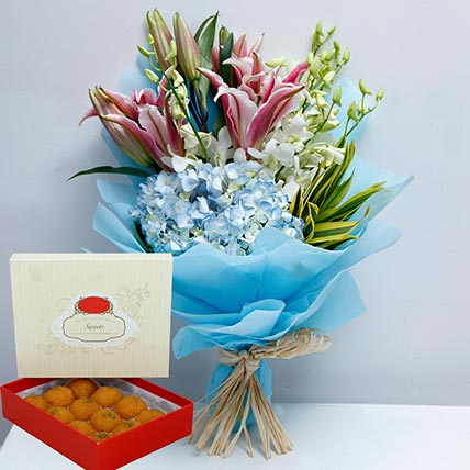 Pretty Flowers Bunch and Motichoor Laddoo Combo: Eid Flowers & Sweets