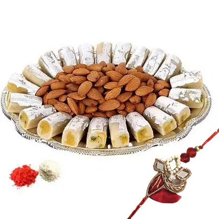 Rakhi with Kaju Roll n Almonds: Rakhi with Sweets