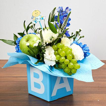 Vase Arrangement Of Flowers And Juicy Fruits: Newborn Baby Gifts