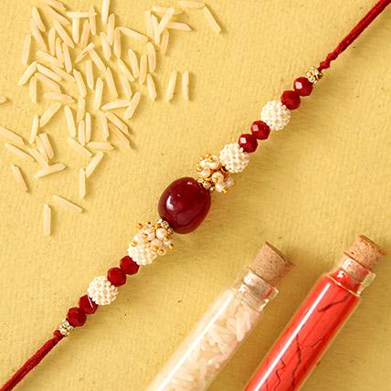 Red Beads Pearl Designer Rakhi: Pearl Rakhi
