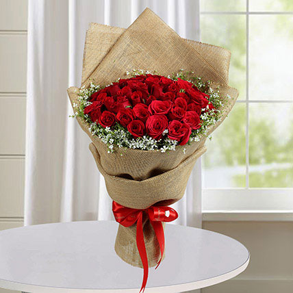 50 Red Roses Bouquet With Brown Wrapping: Flowers To Medina